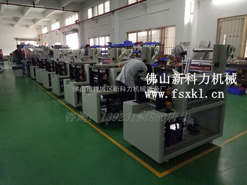产妇纸包装机,带理料枕式产妇纸全自动包装机