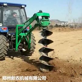 拖拉机挖坑机大型植树机图片